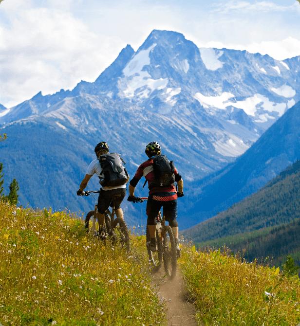 Two tourists taking a mountain bike tour