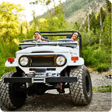Two tourists having fun during a 4WD tour