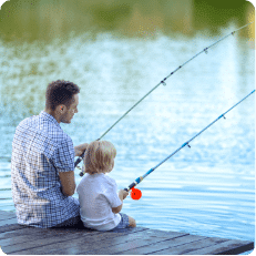 Man and son fishing on a pound during a fishing tour