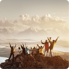 Group of tourists celebrating at the peak of a moutain during a hiking tour