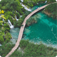 Tourists crossing a brige in Plitvice Lakes National Park