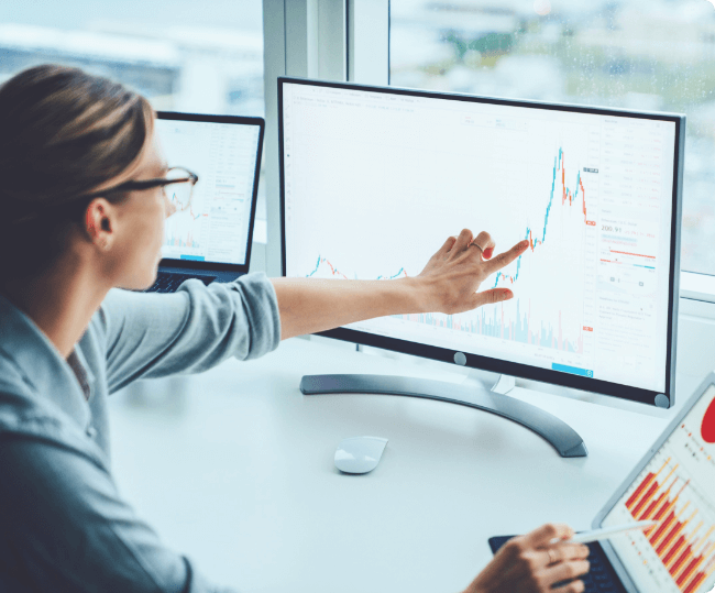 Marketing analyst pointing to a chart