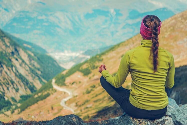young woman meditating yoga tour feedback