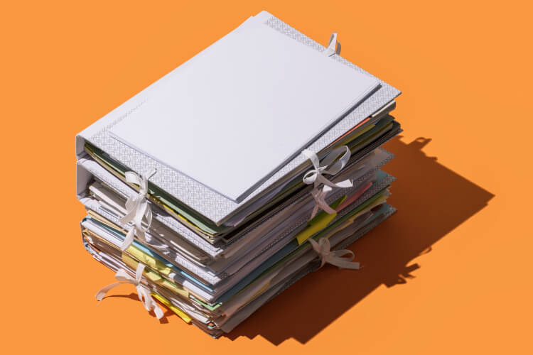pile of folders and paperwork social media marketing strategy for tourism