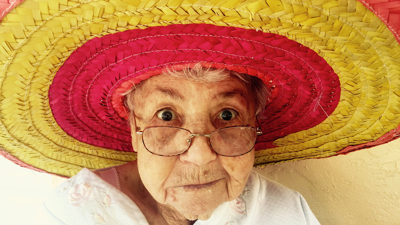 grandma on a vacation, sombrero, senior traveler, older adult traveling, senior citizen