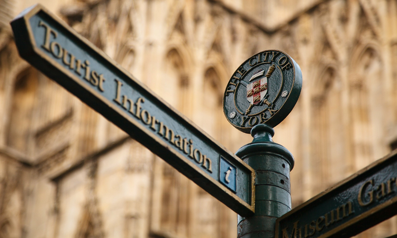 tourist information, distribution channels for tours and trips, street sign, foreign city, tourist