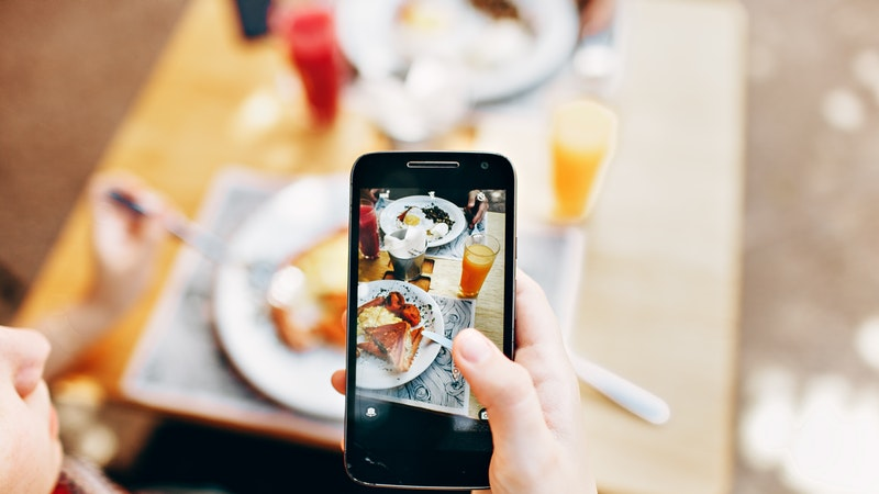 Use a social media influencer to promote your food tour business