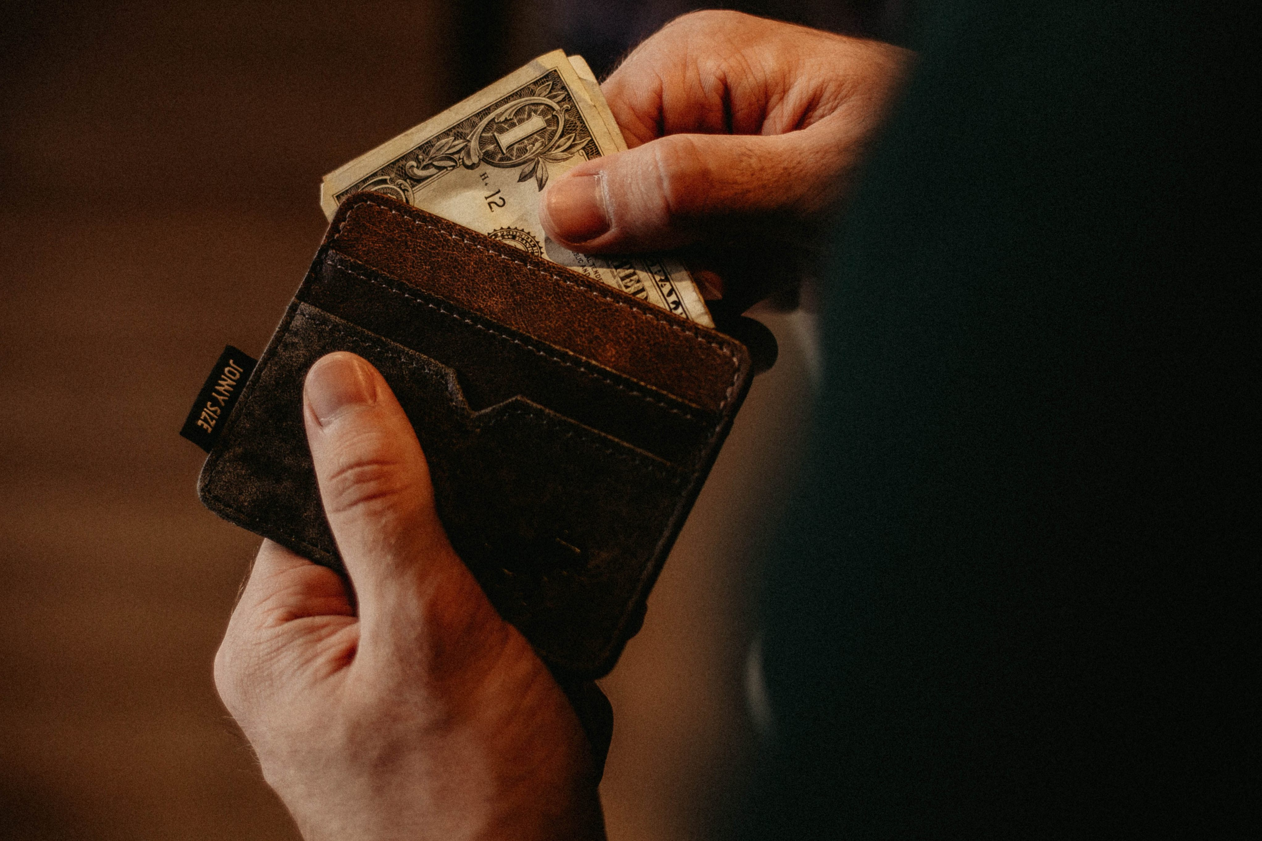 man-counting-money-to-pay-partner