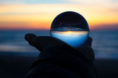 Hand holding a crystal ball.
