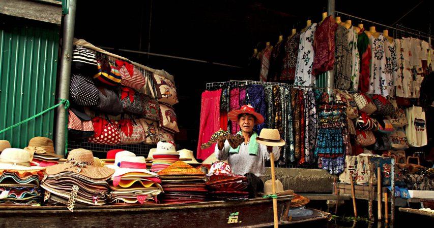 Woman selling hats on a street market