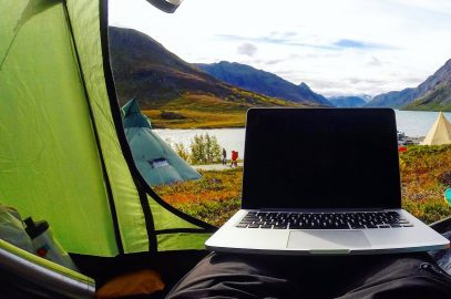 Tourist remote working and enjoying destination.