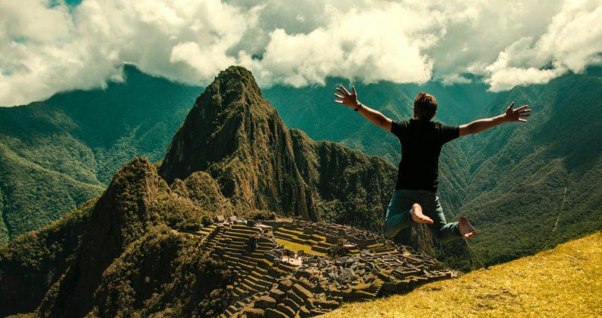 Tourist jumping during machu pichu tour