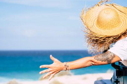 Happy tourist enjoying trip to beach