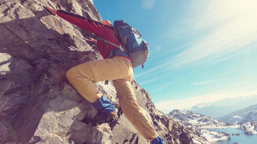 Tour operator climbing stone wall