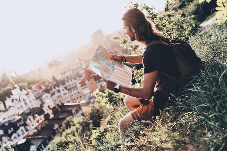 Enjoying the travel man looking at map