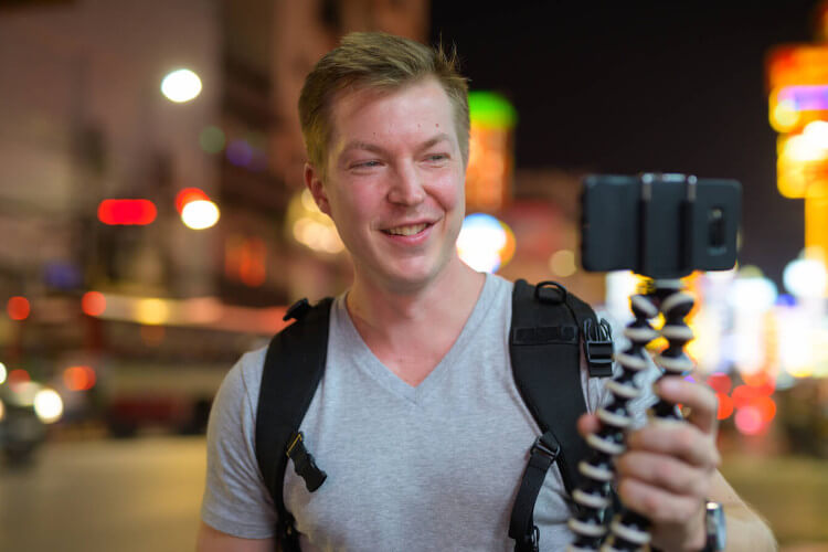Tour guide during a live tour on street in the night