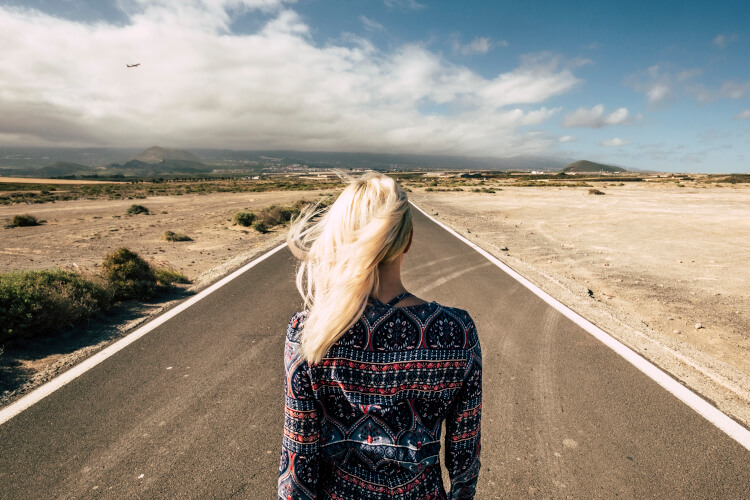 Travel and future choices concept with blonde young woman travel statistics from 2020