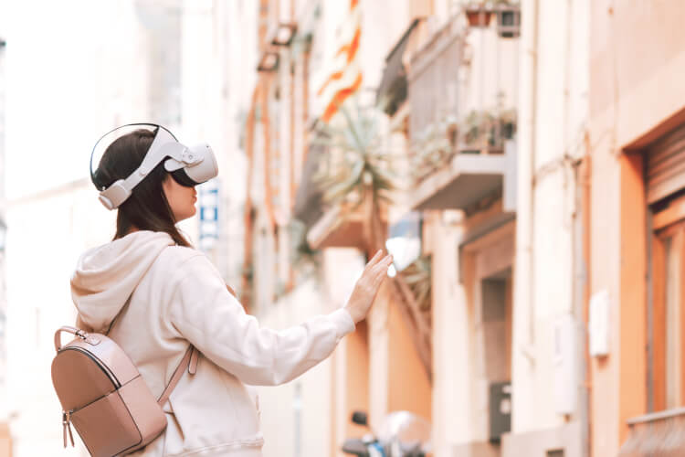 Woman wearing vr headset in european street virtua travel representing the travel statistics from 2020