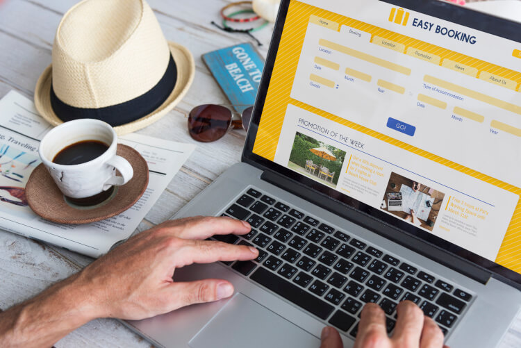 Person booking flight online concept image