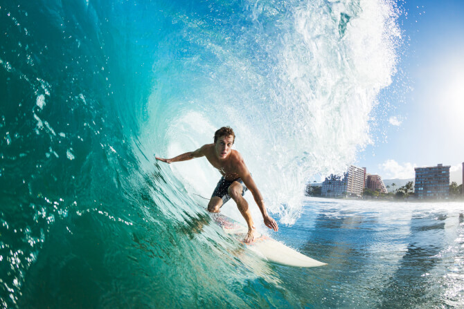 surfer on a wave travel photography tips