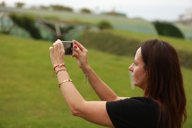 woman takes a picture with a smartphone