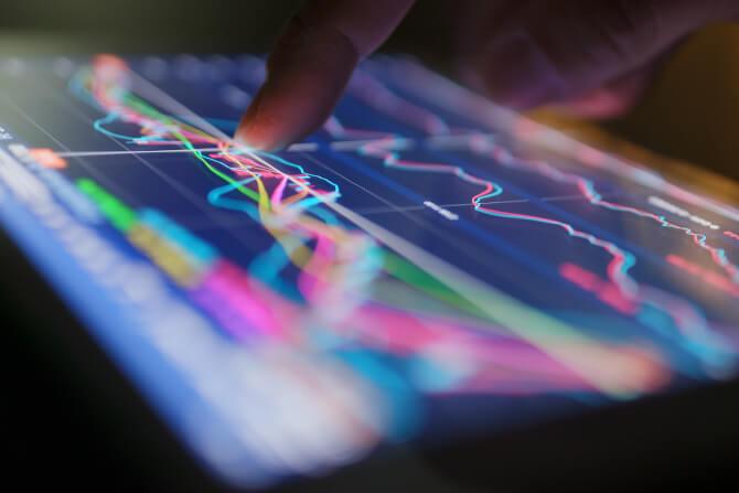 man touching tablet graphs smart destinations
